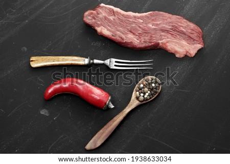 Skirt Steak or Machete Steak on Black Background.  Raw Beef Steaks for Grilling or Roasting Isolated on Black Background, Top View. Uncooked Tenderloin Machete Steak or Bavet Steak.