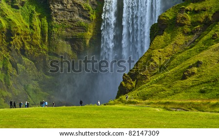 Skogafoss falls and rainbow in Iceland