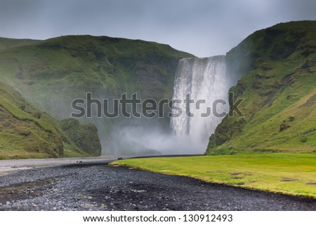 Skogafoss Waterfall, southern part of Iceland, at overcast weather