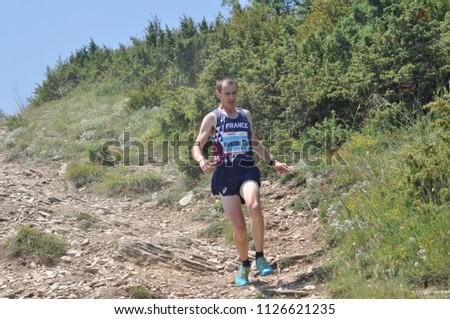 Skopje, Macedonia, July 01 2018. 17th European Mountain Running Championships - Skopje 2018. Competitors run along the tracks of Mount Vodno. (category seniors) #1126621235