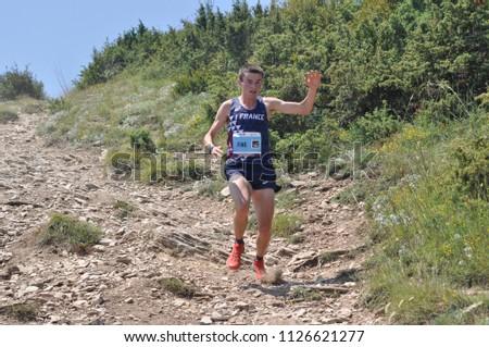 Skopje, Macedonia, July 01 2018. 17th European Mountain Running Championships - Skopje 2018. Competitors run along the tracks of Mount Vodno. (category seniors) #1126621277