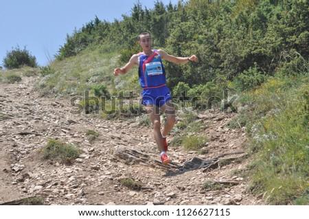Skopje, Macedonia, July 01 2018. 17th European Mountain Running Championships - Skopje 2018. Competitors run along the tracks of Mount Vodno. (category seniors) #1126627115