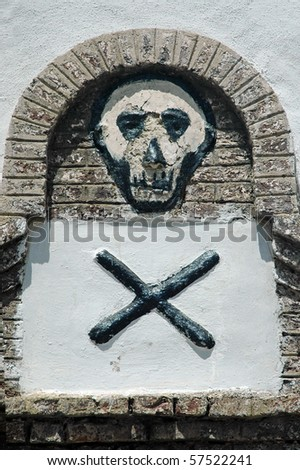 Skull and cross bones on a wall in Elmina castle in Ghana
