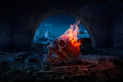 Skull burned in fire in dark Halloween night. Concept of Halloween