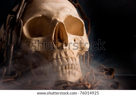 Skull in abstract smoke with chains on it