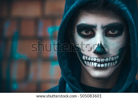 skull makeup portrait of young man halloween face art 505083601
