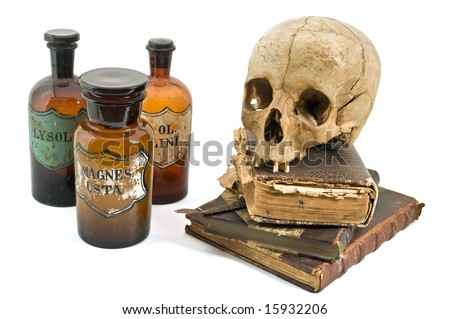 skull, old books, old drug bottles isolated on white - stock photo