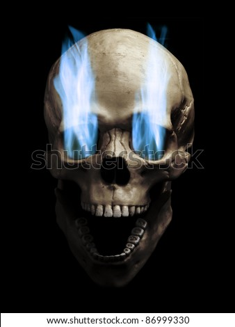 Skull with blue flaming eye sockets over black background - stock photo
