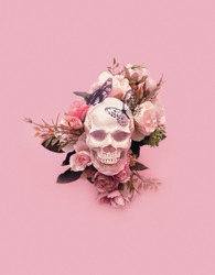 skull with flowers and butterflies on pink background. creative concept. magic surreal image. atmosphere  witch ritual