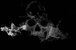 Skull with smoke. Real skull in abstract smoke