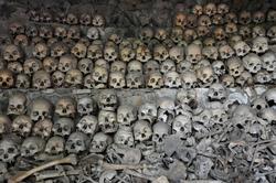 Skulls and bones in Opdas Mass Burial Cave, Benguet, Philippines.