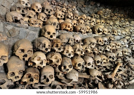 Skulls and bones in Opdas Mass Burial Cave, Benguet, Philippines - stock photo
