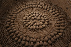 Skulls and human bones in ancient catacomb in Peru, South America.
