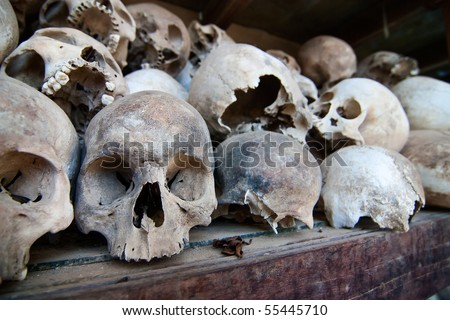 Skulls of torture victims rest in a stupa at the Killing Fields outside of Phnom Penh, Cambodia.