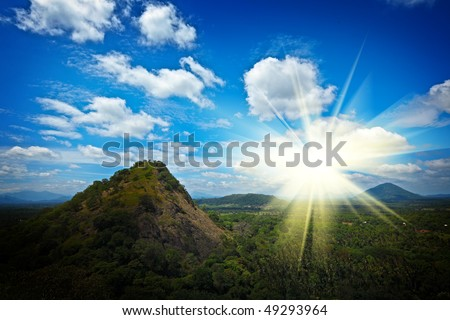 Sky above small mountains, covered with trees. Sri Lanka