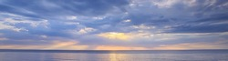 sky above water / texture background, horizon sky with clouds on the lake