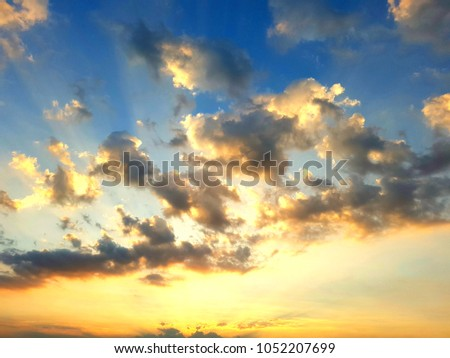 sky and clouds are blue and gold is a beautiful background #1052207699