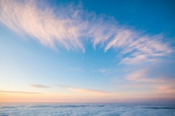 Sky and clouds beautiful rare landscape - blue colors and horizon - beauty of outdoor nature - fly and travel concept - sunset or sunrise time and.  natural coloured background at the mountain