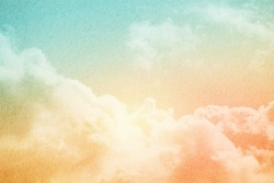 sky and soft cloud with pastel color filter and grunge paper texture , nature abstract background