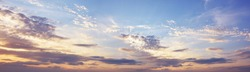 Sky at sunset with dark clouds, panoramic big shot. Background from the cloudy sky.