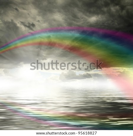 Sky background with rainbow and reflection in water. Sunset