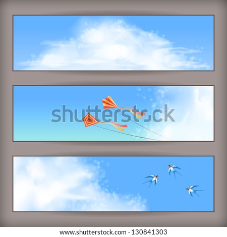 Sky banners with white fluffy clouds, blur, flying kites and birds (swallows) on a clear summer day. Horizontal background design with space for text at the backdrop in blue pastel colors