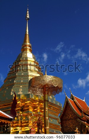 Sky blue and gold pagoda at Wat Phra That  Doi Suthep, are county  Chiang Mai, Thailand. The golden pagoda contains the Holy Buddha Relic