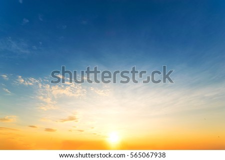 Sky blue and orange light of the sun through the clouds in the sky survive. #565067938