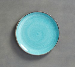 Sky Blue Swirl Melamine Plate with dark gray background