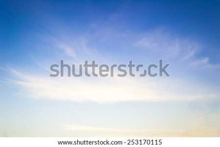 Sky blur natural background calm peaceful evening sunset yellow twilight with wind blow cloudscape and white soft clouds #253170115