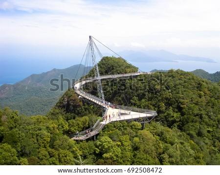 Sky bridge atop the rainforest of Langkawi Island, Malaysia. #692508472