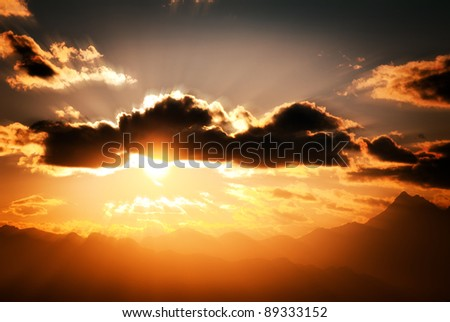 sky clouds and sun in mountain landscape