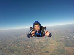 Sky diving asian female smiling