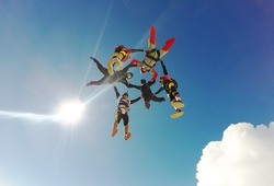 Sky diving group formation low angle view