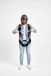 Sky diving men. Gesture class. Men in parachute equipment and helmet shows gesture class. Skydiving men in parashute.
