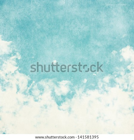 Sky, fog, and clouds on a textured, vintage paper background with grunge stains