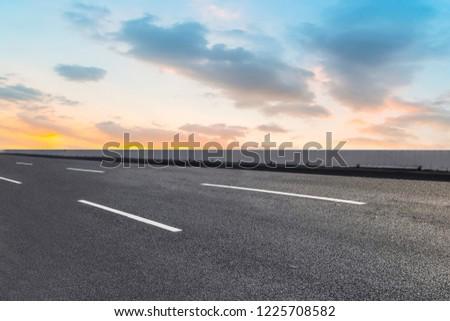 Sky Highway Asphalt Road and beautiful sky sunset scenery #1225708582