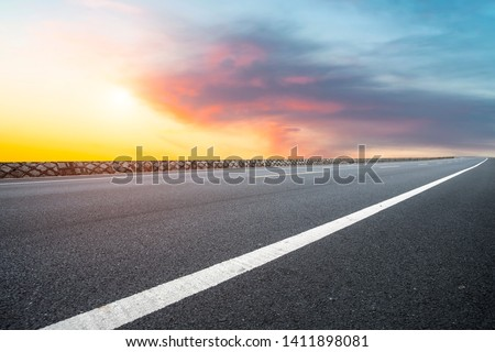 Sky Highway Asphalt Road and beautiful sky sunset scenery stock photo