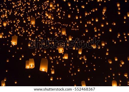 Sky lanterns, flying lanterns, floating lanterns, hot-air balloons Loy Krathong Festival in Chiang Mai Thailand  - Shutterstock ID 552468367