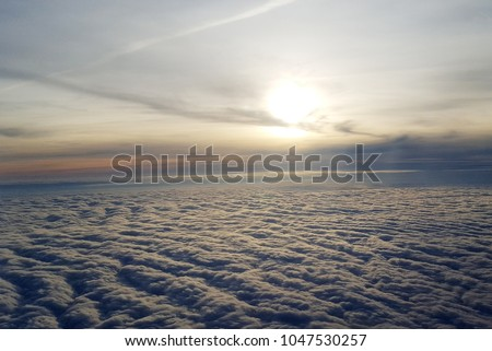 Sky over the clouds #1047530257