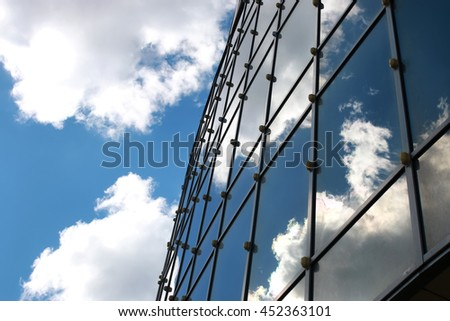sky reflected in office building
