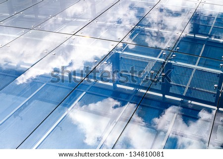 sky reflecting in the glass of...
