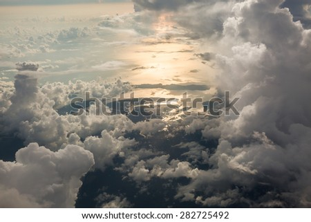 Sky scape cloudscape before sunset.View from window of airplane flying in clouds over Phuket,Thailand