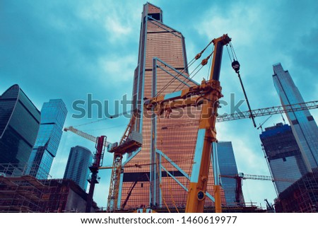 Sky scraper tower construction site with cransSky scrappers construction site #1460619977