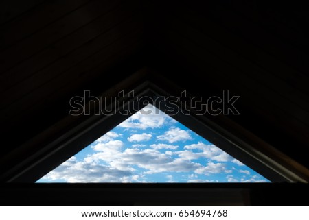 Sky seen through windows. Abstract Triangle of the sky. Triangle shape window showing the picture of blue bright sky giving hope and opportunity amidst the darkness inside.