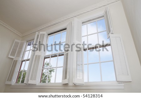 Sky seen through windows with louver shutters