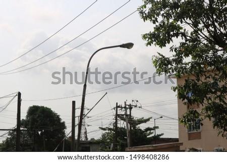SKY/STREET LIGHT IN DAYLIGHT IN NIGERIA #1498408286