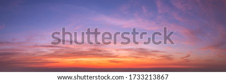 Sky sunset background panorama concept. Skyline top view Evening sunset sky and the morning sunrise In the city Colorful with copy space. Empty beautiful sky panoramic view twilight time of Bangkok