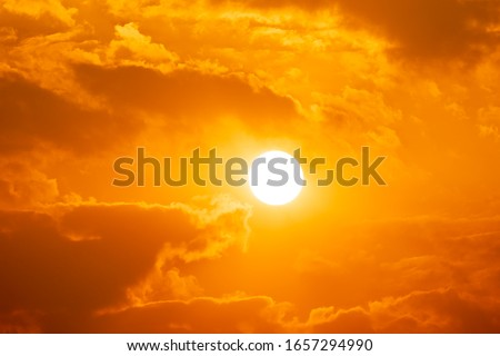 Photo of  Sky sunset of sunshine and cloud, bright twilight background. Everything lies above surface atmosphere outer space is sky. Cloud is aerosol comprising visible mass  liquid, for creative design graphic