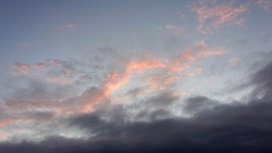 sky sunset with gray and pink clouds with blue background